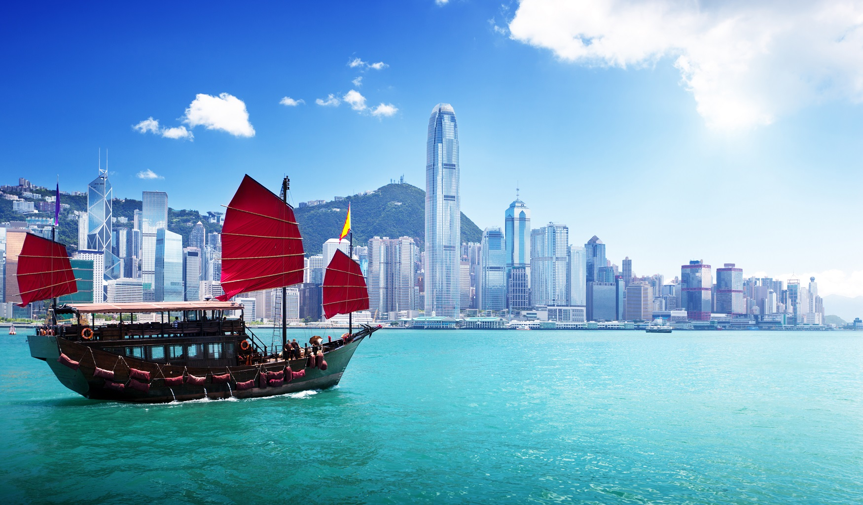 Photo of Ship in Front of Hong Kong skyline