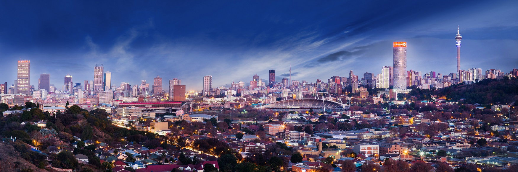 Photo of the skyline in Johannesburg with skyscrapers and sunset