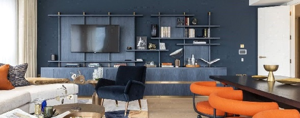 Photos of a stunning living room with orange and blue colour schemes