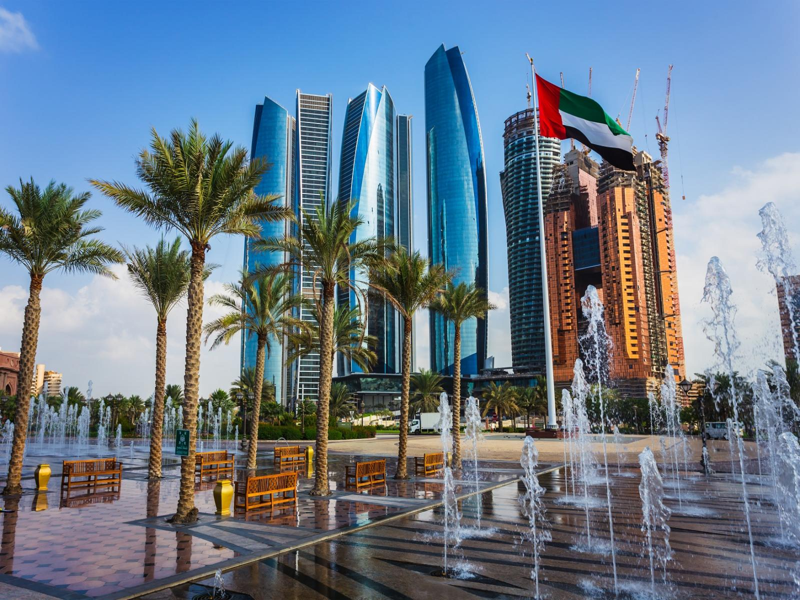 Photo of skyscrapers behind a fountain in Abu Dhabi