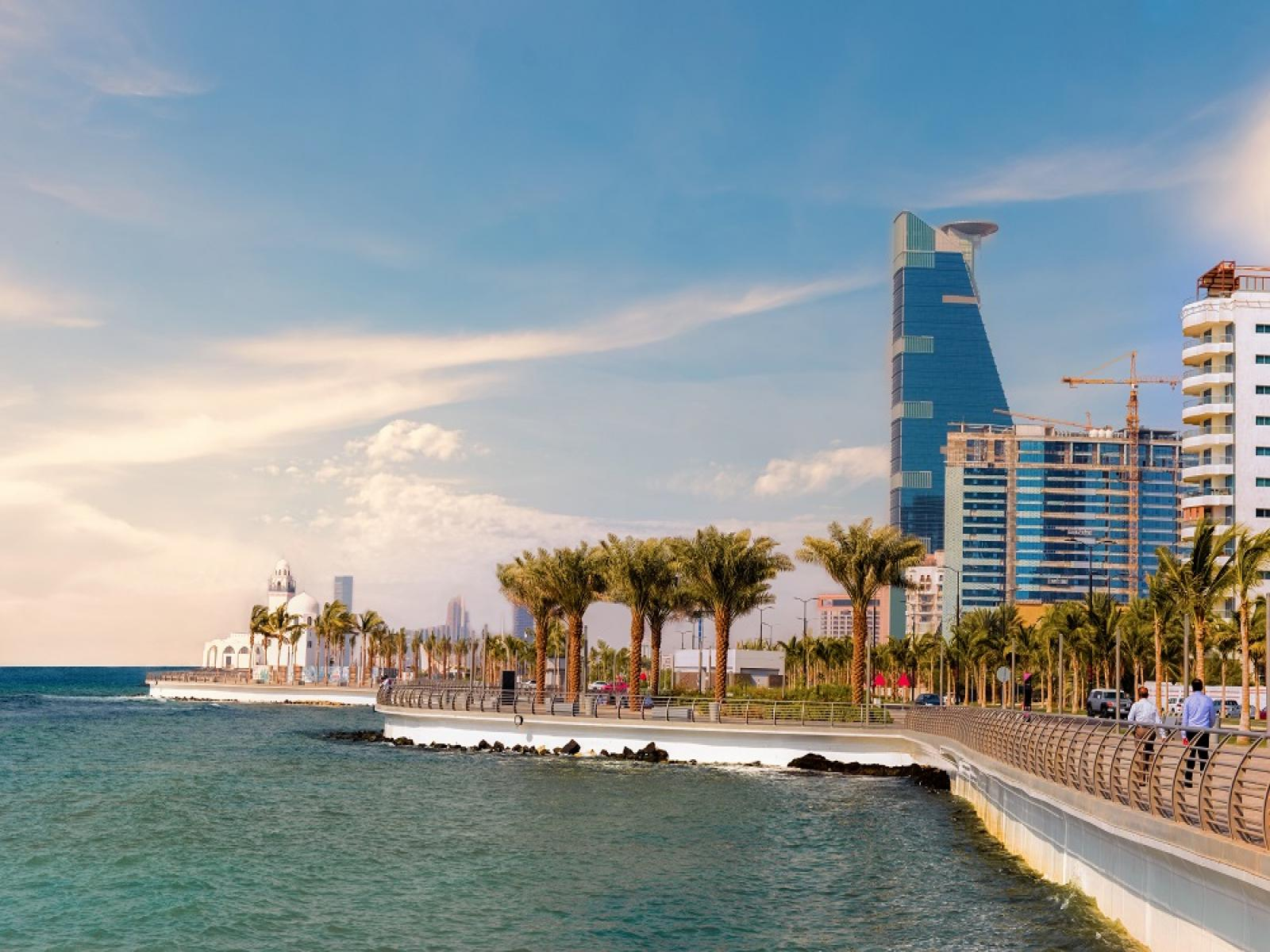 sunny photo of the coast line with buildings in Jeddah